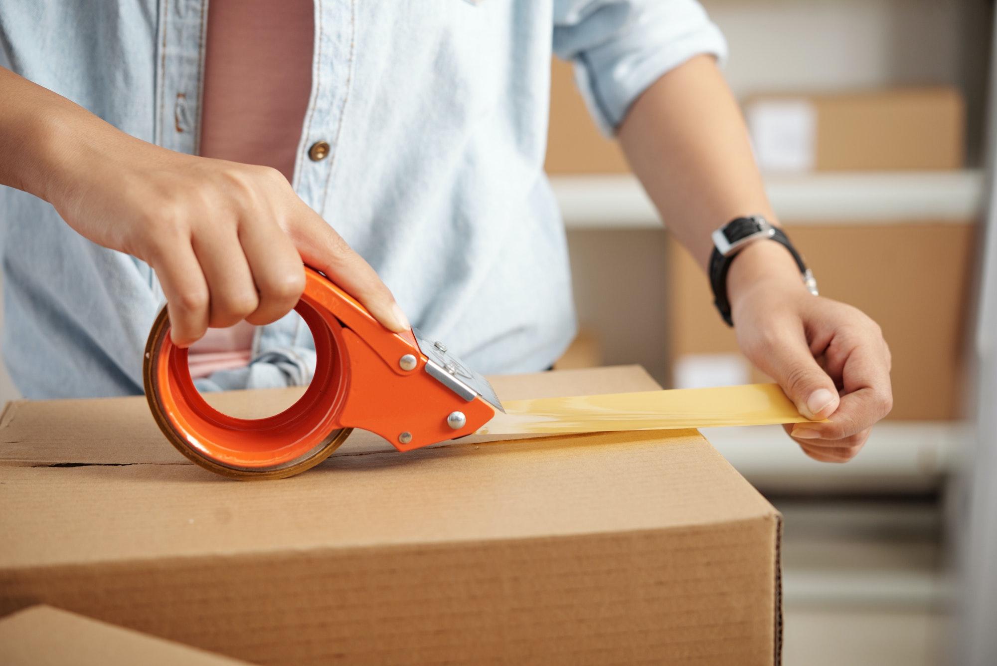 Woman packing box